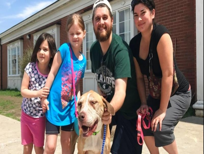 Family reunited with lost dog found four years later in Toledo