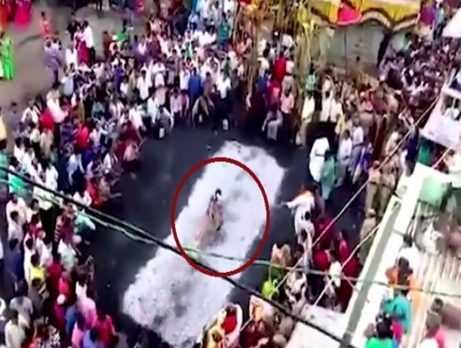 Video: Woman falls on hot coals as she trips on saree during fire-walking ritual