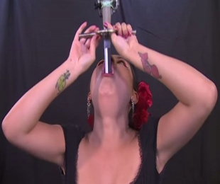 Watch: Pregnant woman swallows swords for a living