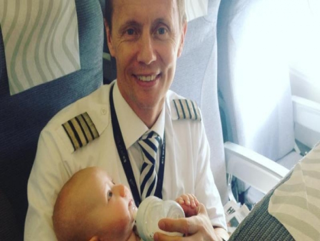 This Finnish pilot fed a baby on flight and it is the best thing you will see today