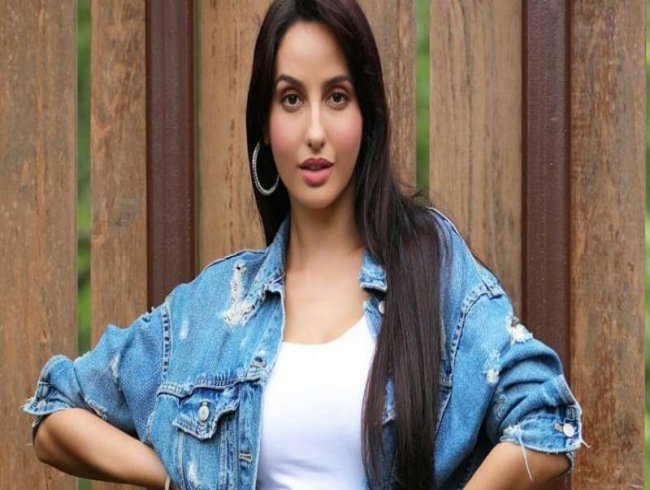 Nora Fatehi teaches how to ace long denim jackets with her latest look