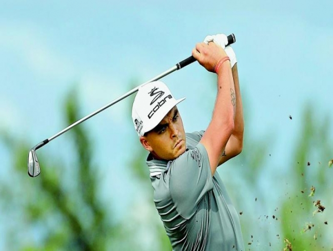 Golf's young guns up for Tiger Woods challenge