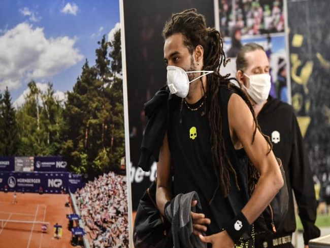 Dustin Brown's masked men bring tennis back to sound of silence