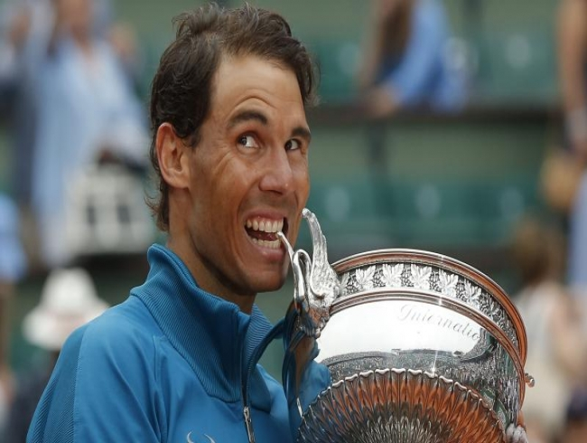 Passing Federer's 20 Slams not on agenda, says Nadal after 11th French Open triumph